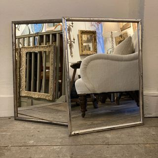 A Pair of Siver Gilt Mirrors